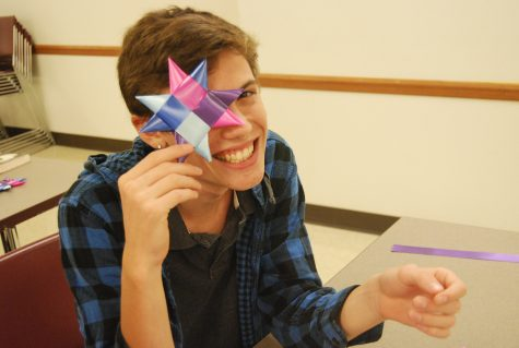 Senior Jacob Taylor proudly poses with his star after struggling to create one.