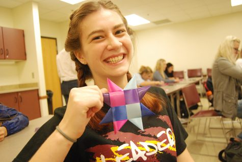 Star weaving veteran and sophomore Grace Golden grins as she shows off her first star of the day.