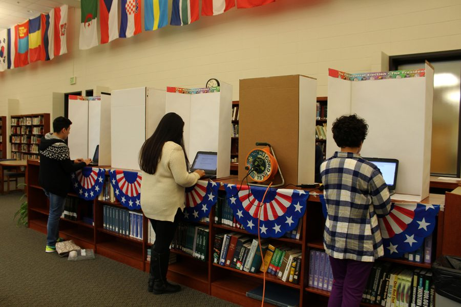 North+students+that+participated+in+the+BHSN+mock+election+that+was+set+up+in+the+library+by+Mr.+Muehlhaus+stand+at+the+fake+voting+machines+to+cast+their+ballots.+