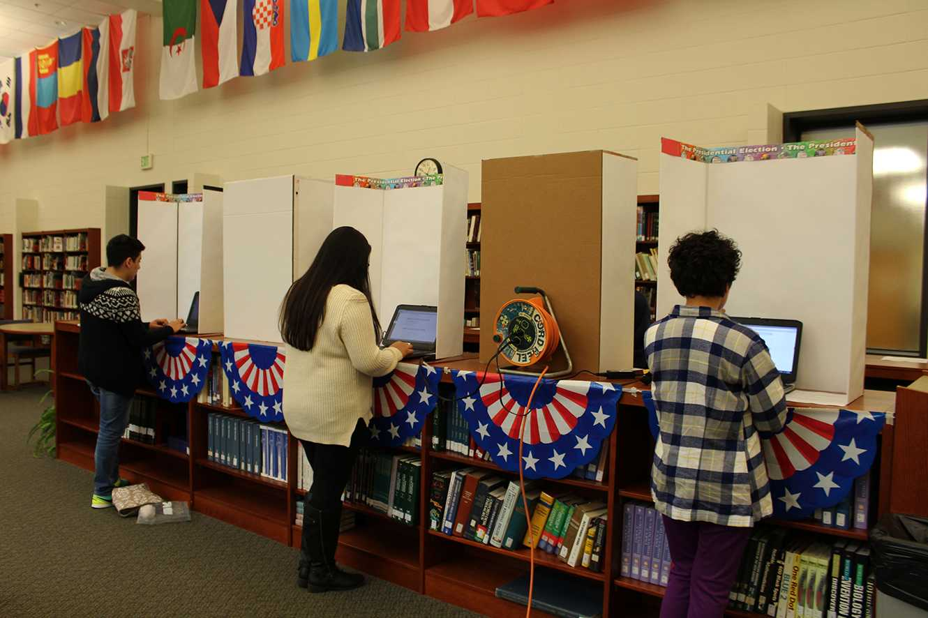 North students that participated in the BHSN mock election that was set up in the library by Mr. Muehlhaus stand at the fake voting machines to cast their ballots.