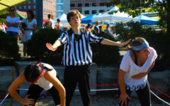 Ryan Eller acts as the ref during Ostlund and Barker's faux boxing match