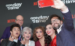 The stars of One Day at a Time pose for a group selfie at the show's launch in 2017.